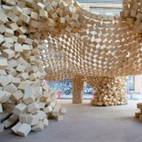 7000 wooden cubes linked together in an inverted question-cube